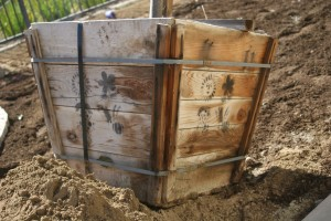 weathered cedar wood container with cool stencils and interesting metal straps