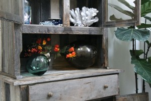 a rustic front entry with vintage buoys and Dinky cars