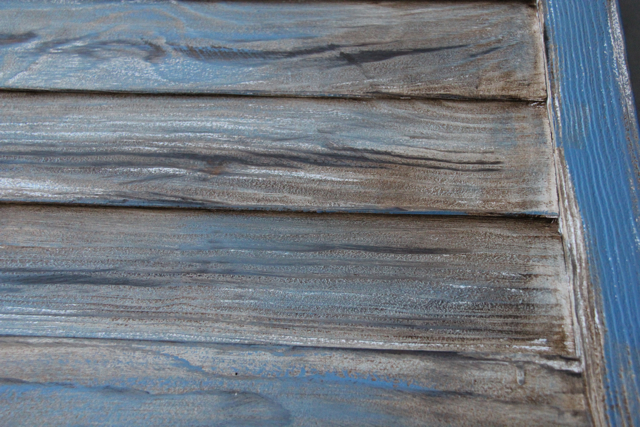 sanded white shutter with dark wood stain and dry brushed dark blue cu