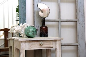 beachy chic side table with sea shells, glass float, and coral