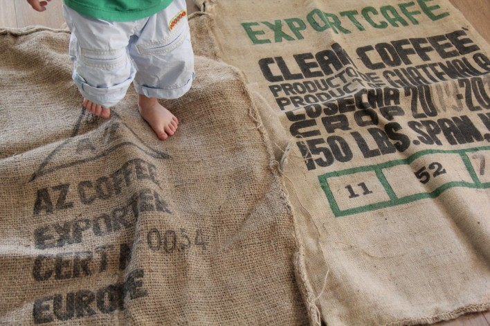 toddler walking on coffee sacks