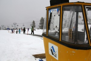 old school Vail gondola at top of magic carpet
