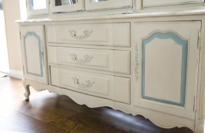 bottom half of antique hutch painted in Annie Sloan Old Ochre and duck egg