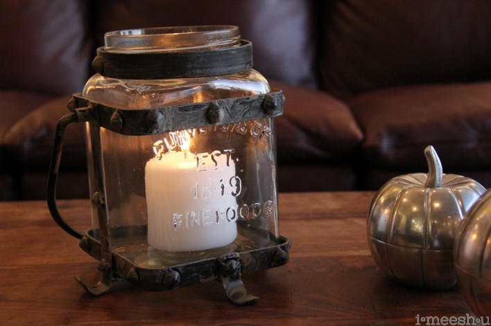 metal and glass hurricane jar with candles One Kings Lane