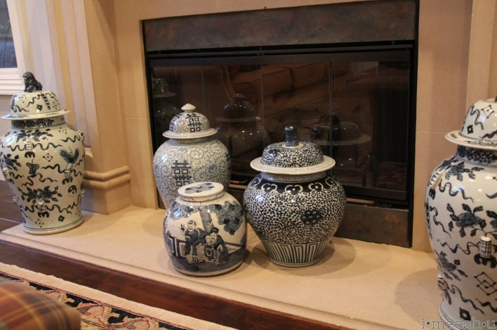 blue and white asian vases on traditional fireplace hearth