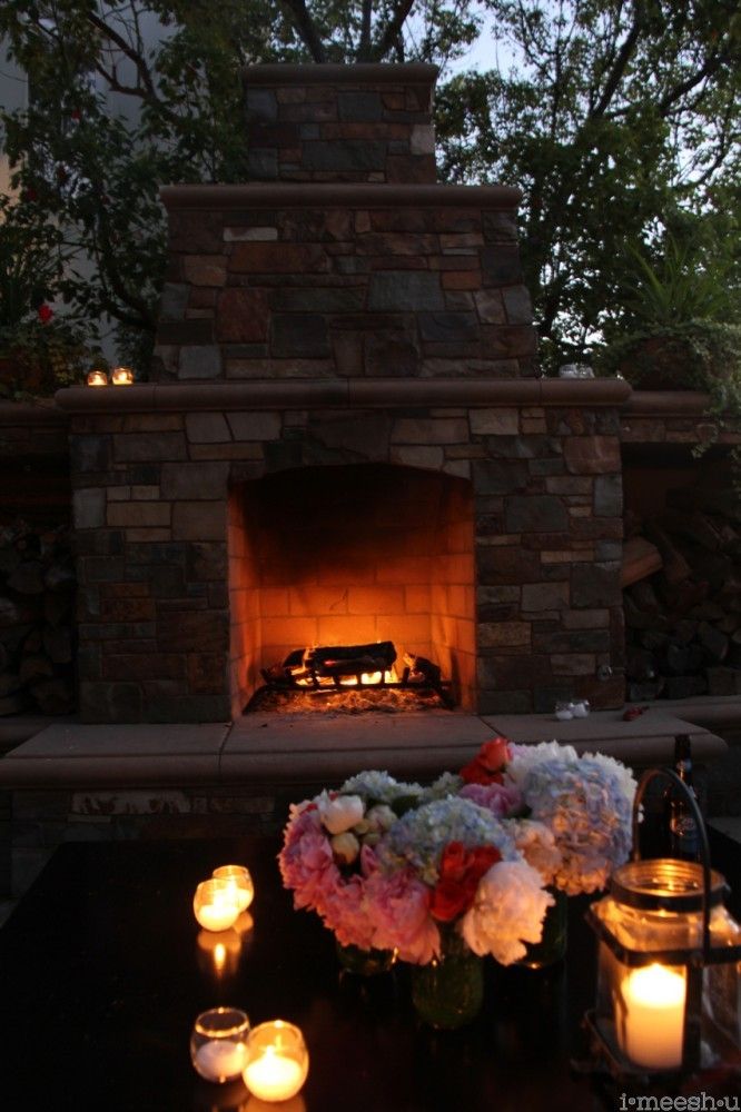 outdoor fireplace with hyndrangeas and candles