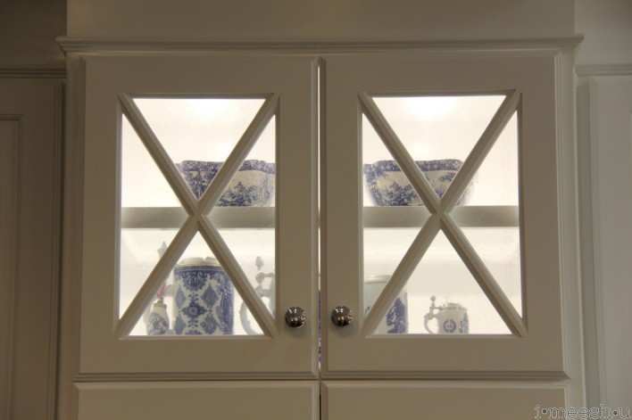 beaded glass kitchen cabinet with blue and white vases