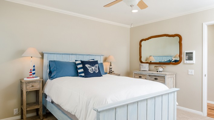 transform a dark wood bed into a beachy chic treasure