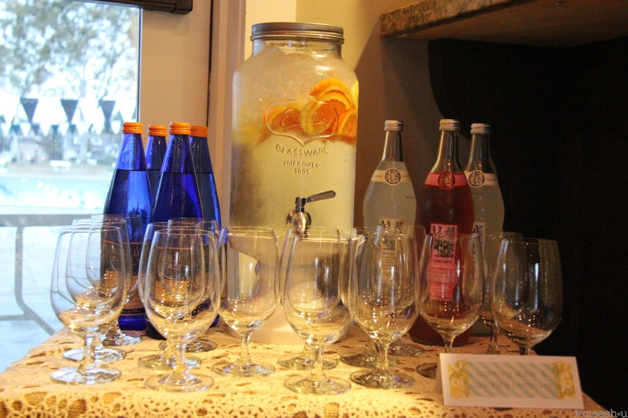 drink bar with real glassware for a baby shower go girls