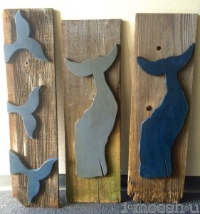weathered wood whale tails