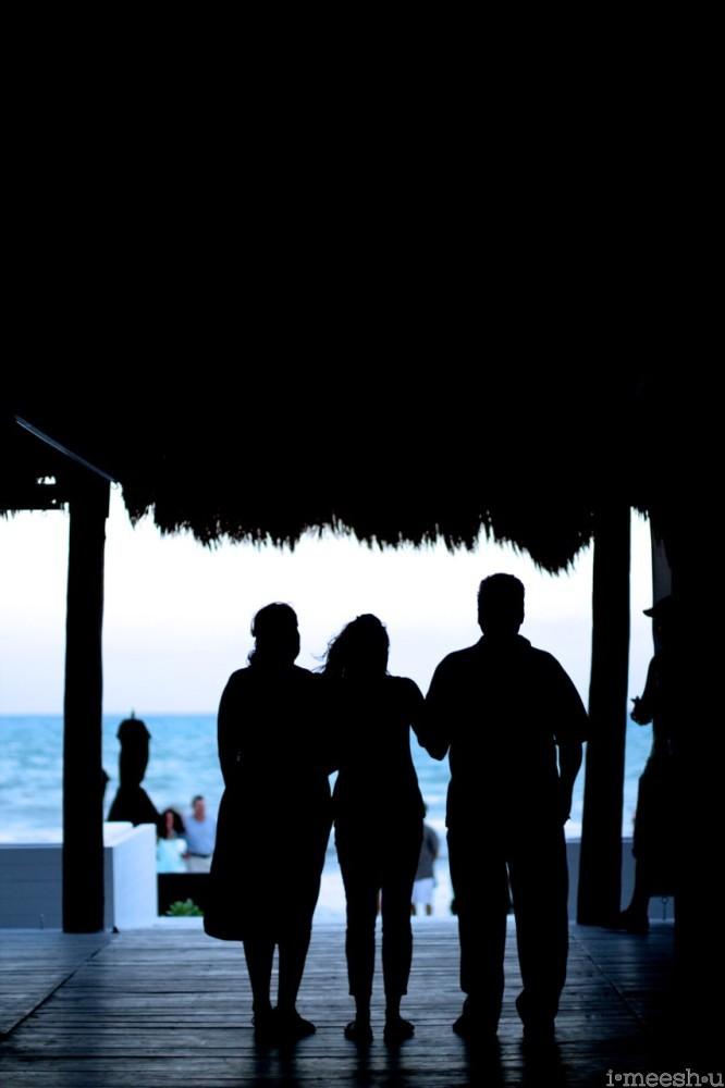 mom-daughter-dad-wedding-rehearsal-beach-palapa